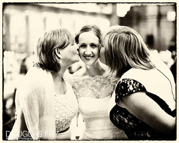 Wedding Photographer capturing bride with friends