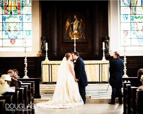 Bride and groom in church at St Lawrence Jewry - London