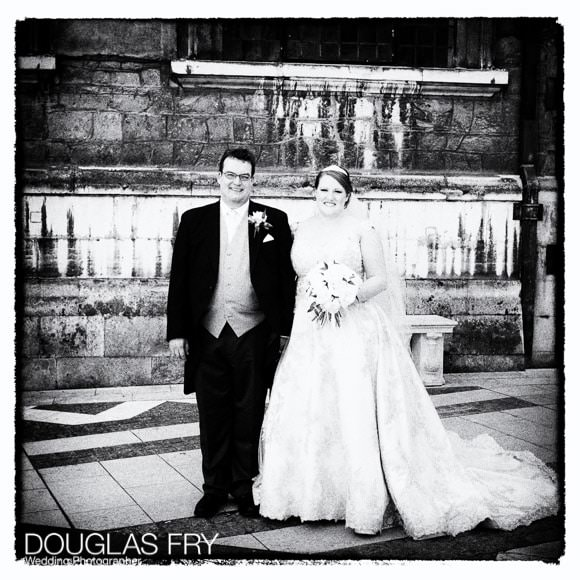 Bride and groom pictured outside the church after the service - in black and white