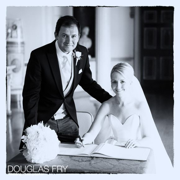 Bride and groom at Syon Park - Wedding Photograph in black and white - signing the register