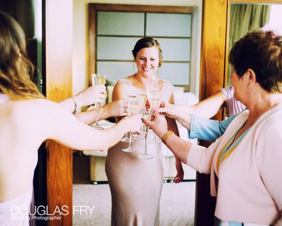 The Devonshire Terrace - Bride Getting Ready with Champagne