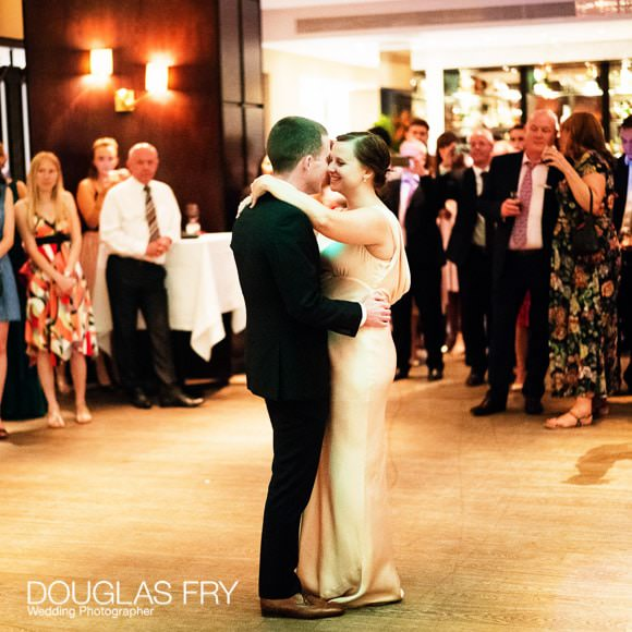 Couple during first dance in the evening.