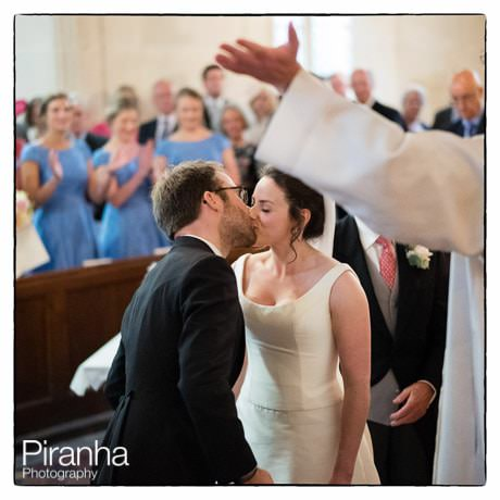 Bride and groom in church during ceremony
