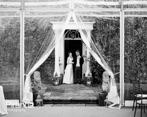 Bride and groom about to enter marquee