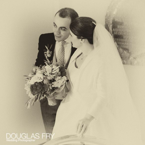 Sepia photograph of bride and groom at Cafe Royal in London