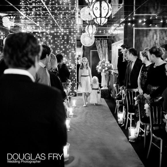 Bridesmaids walking down aisle at Crazy Bear wedding in Beaconsfield