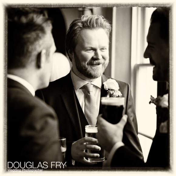 Groom pictured during reception at the Gun in Docklands