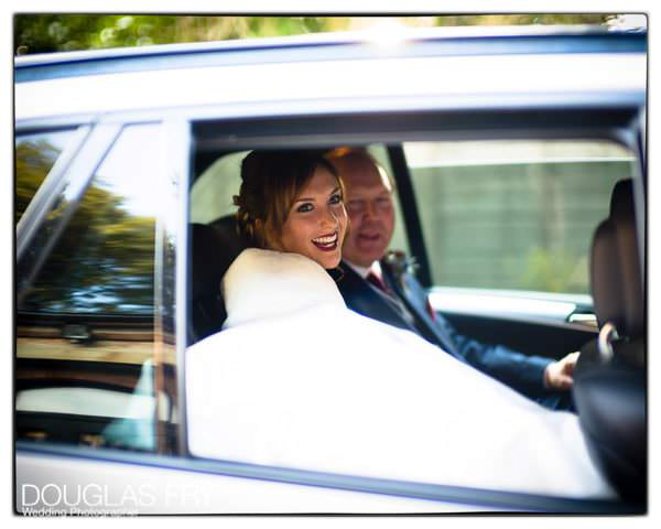 Bride and father of the bride arrriving in car at wedidng venue taken on Leica cameras