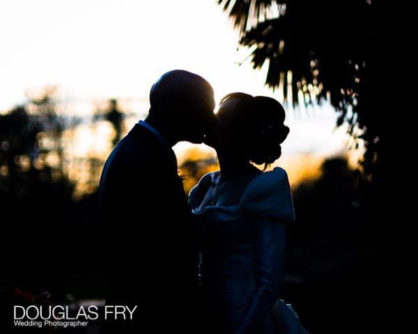 Bride and groom kissing outside Hampton Court House - Leica photograph