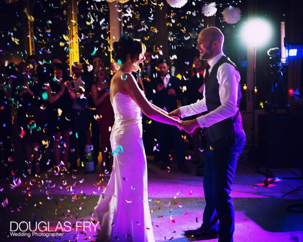 Bride and groom dancing with confetti - Leica image