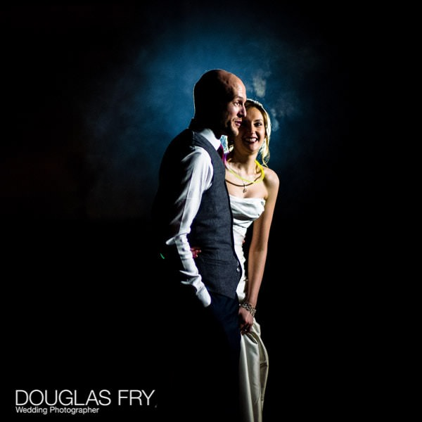 Photograph taken on Leica camera and lens at wedding at Hampton Court House of bride and groom outside watching fireworks