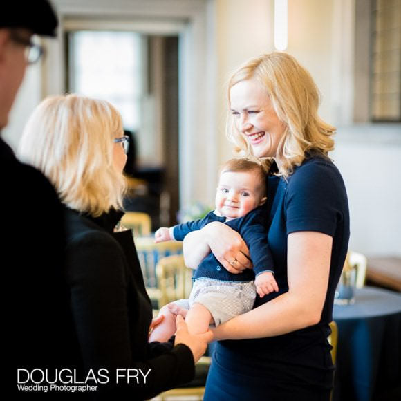 Photograph of Ene with Harry during naming Ceremony