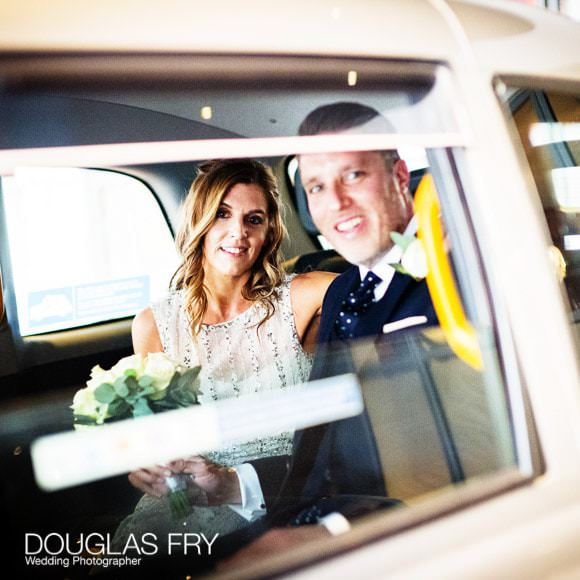 Bride and Groom in Taxi on way to Union Club in Soho