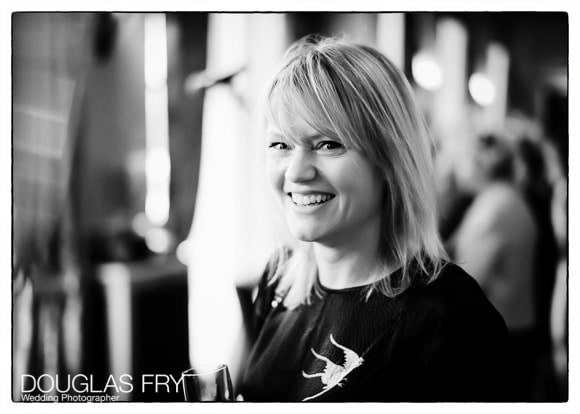 Black and white portrait of guest during wedding