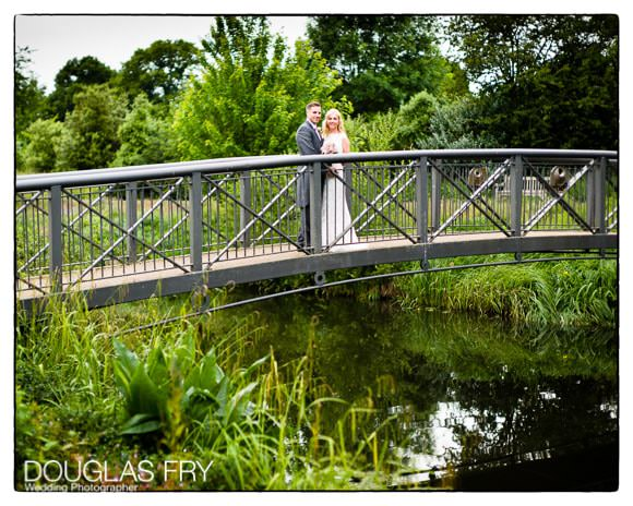 Couple standing on bridge at Syon Park