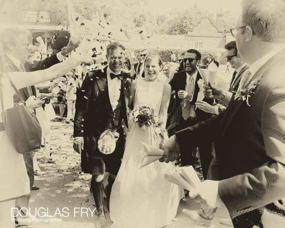 Bride and Groom with confetti during London wedding