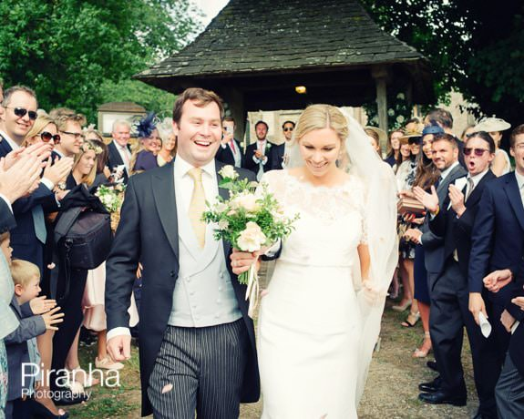 Bride and groom pictured with confetti in Gloucestershire