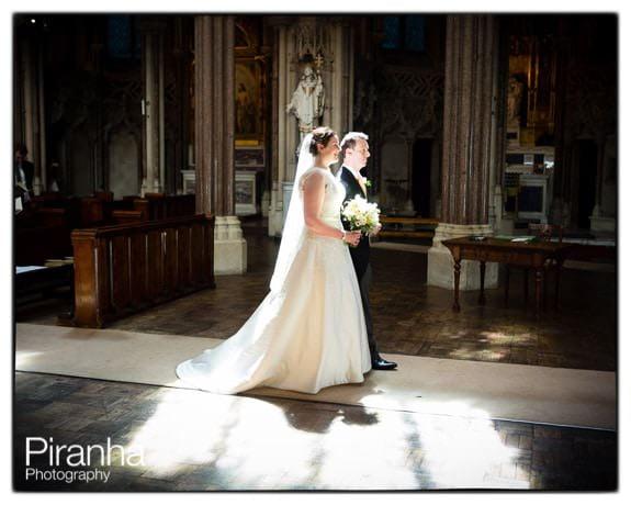 Bride and Groom walking down aisle in Farm Street Church