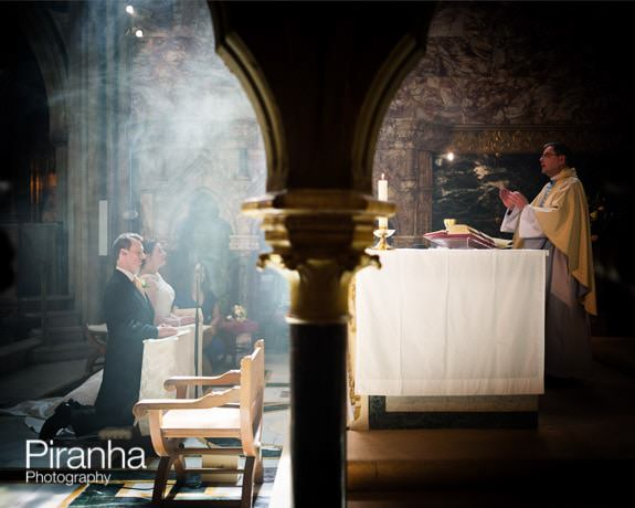 Wedding service with priest photographed in Farm Street Church