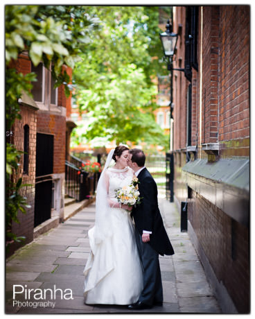 Kiss in London street for bride and groom on wedding day