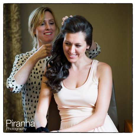 Bride getting ready at hotel in London - having her hair arranged
