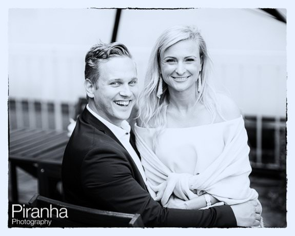Black and white photograph of couples friends during wedding reception