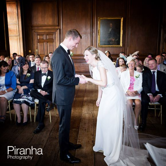 Bride and groom laughing during ring exchange at civil ceremony