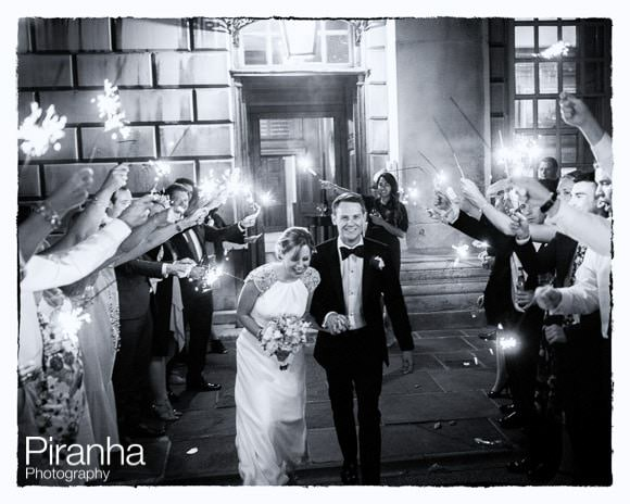 Bride and groom photographed going away through sparklers at Admirals House in Greenwich