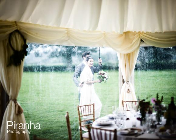Bride and groom outside marquee at wedding reception