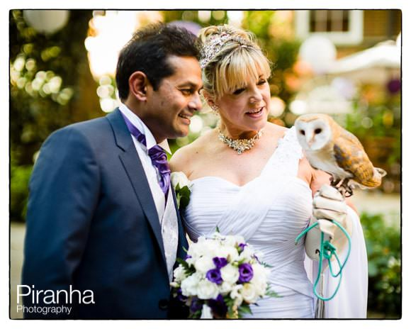 Couple with bird of prey at wedding reception at Stationers' Hall in london