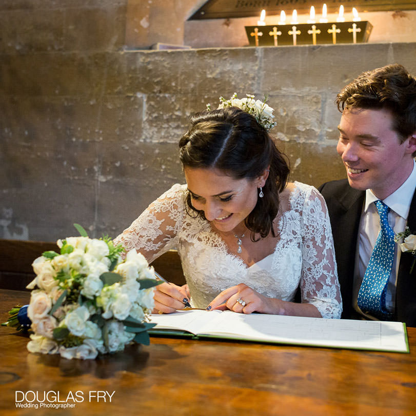 Signing the register in Hampshire church after wedding