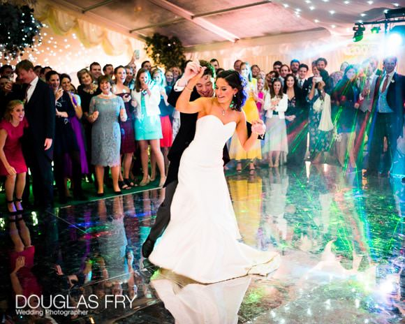 Bride and groom dancing on mirrored dance floor