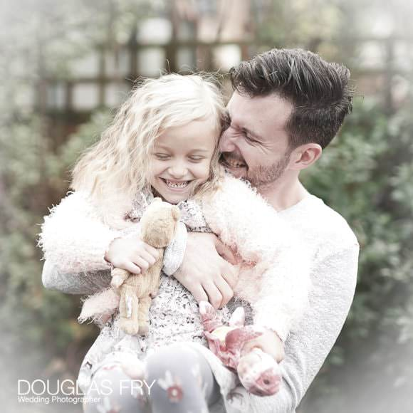 Father and daughter photographed together during photo shoot