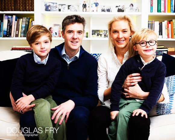 Family photographed together at home for Christmas card