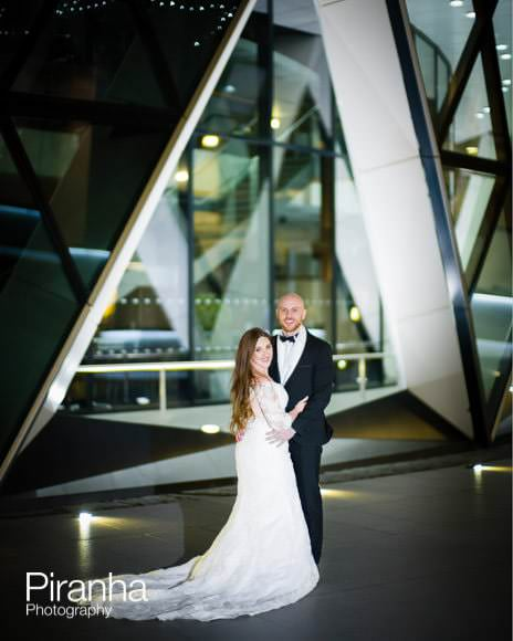 Bride and groom photographed in front of Gherkin
