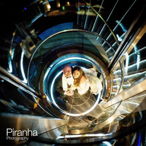 Bride and groom photographed on Gherkin staircase