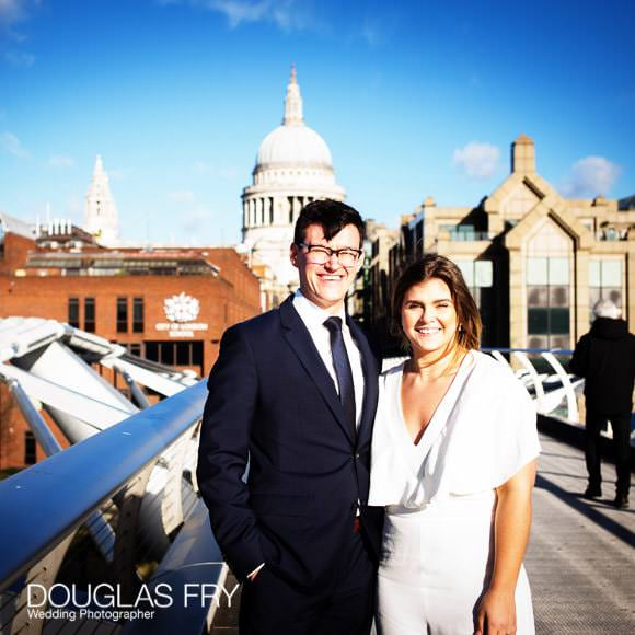 Wedding photograph on Millennium Bridge in London with St Pauls