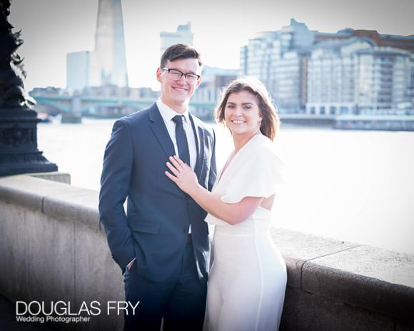 Couple photographed in London by Tate modern with the Shard in the background