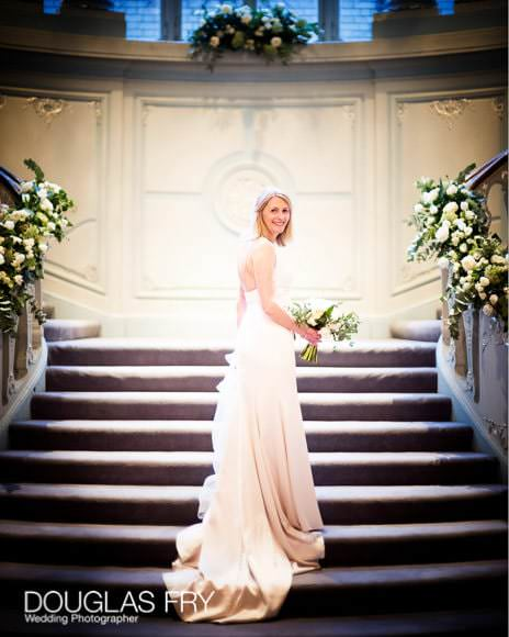 Bride ascending the stairs at the Savile Club in London
