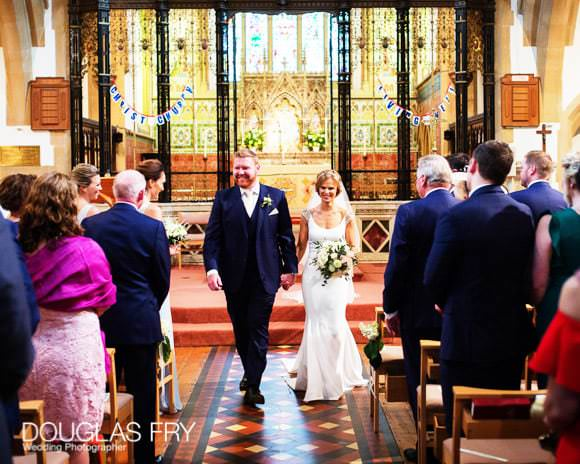 Bride and groom leaving church after service.