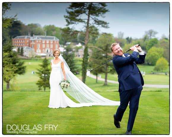 Groom with golf club and bride in front of RAC Epsom