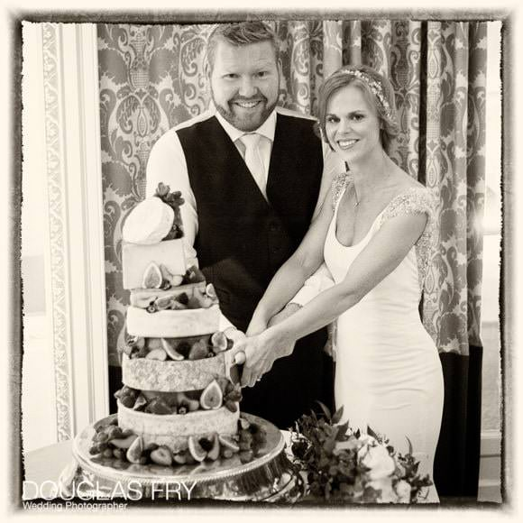 Bride and groom cutting cake at RAC in Epsom
