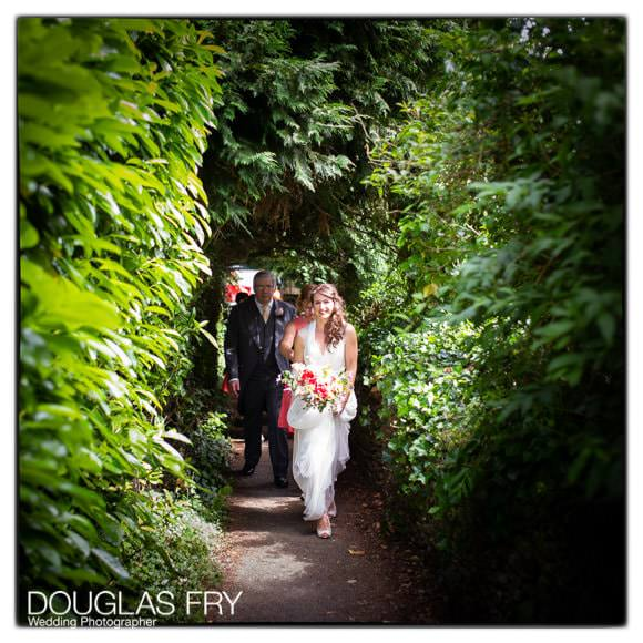Bride arriving at Church through woodland walk