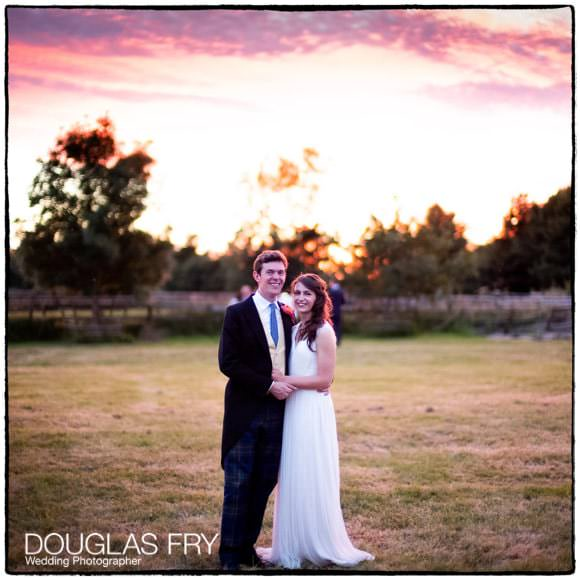 Bride and groom photographed during sunset at Gloucestershire wedding