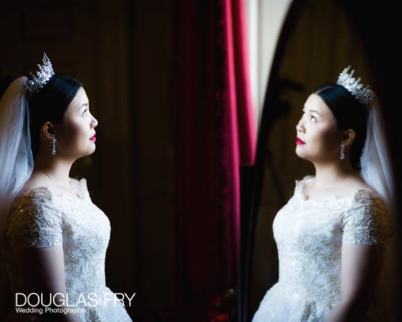 Bride photographed in mirror at Admirals House, Old Royal Naval College