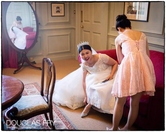 Bride and bridesmaid preparing for wedding ceremony at Admirals house in Greenwich