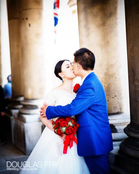 couple kissing at Old Royal Naval College in Greenwich