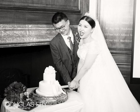 Couple cutting cake at Old Royal Naval College