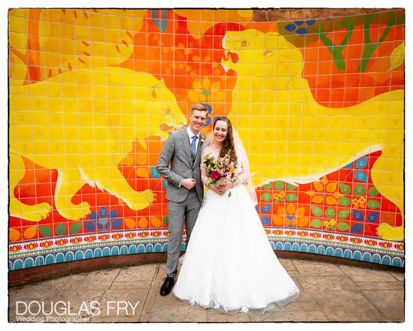 Wedding picture by lion murial at London Zoo