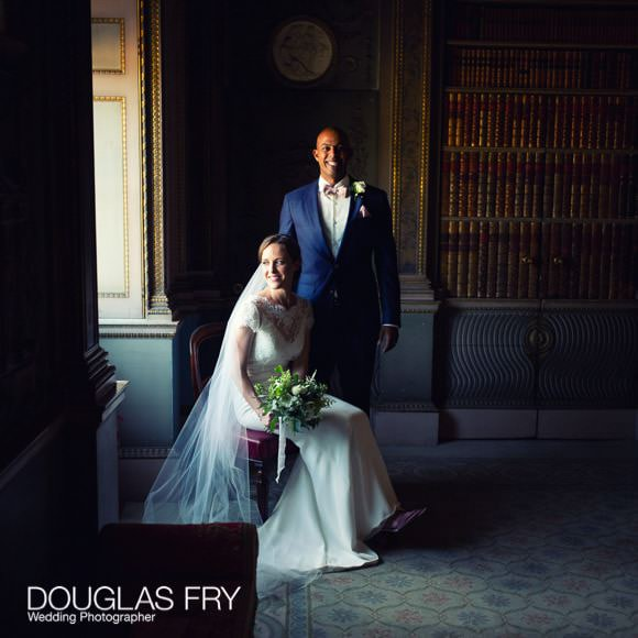 Couple photographed by window in Syon House